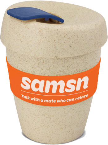 Cream colored reusable coffee cup with orange heat resistant band, secure lid and flip closure bearing the SAMSN logo